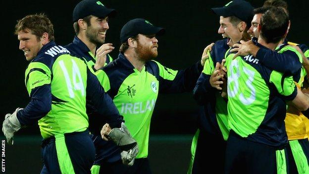 Gary Wilson (left) joins the Irish celebrations after the win over Zimbabwe