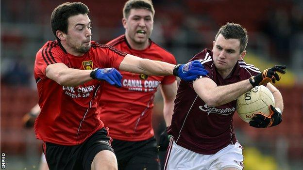 Down's Damien Turley tackles Galway forward Michael Martin