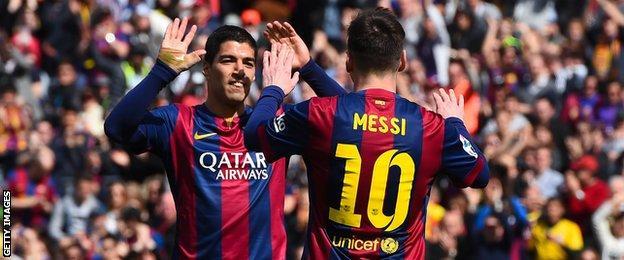 Luis Suarez and Lionel Messi celebrate
