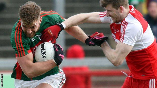 Mayo's Aidan O'Shea attempts to fend off Niall Holly.