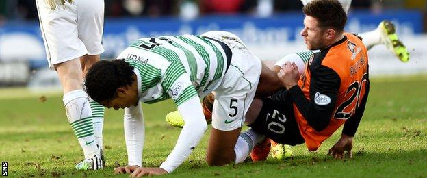 Virgil van Dijk and Calum Butcher clash