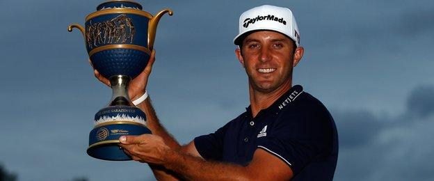 Dustin Johnson with the WGC Championship trophy