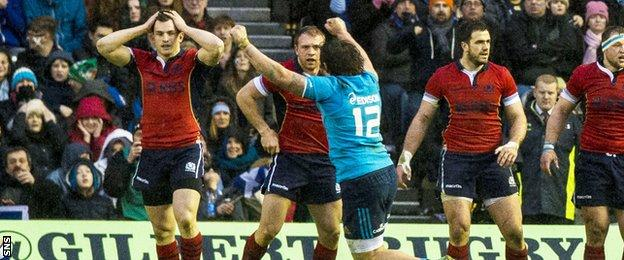 Italy's Enrico Bacchin celebrates at full-time as his side narrowly defeat Scotland 22-19.