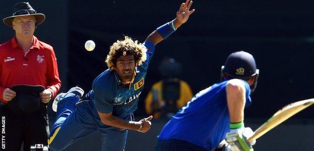 Lasith Malinga bowls against England