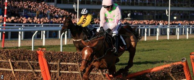 Annie Power and Ruby Walsh (r) falling at the last