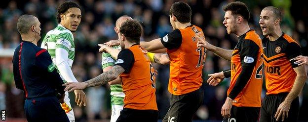 Celtic's Virgil Van Dijk is confronted by Dundee United players