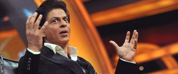 Bollywood star Shah Rukh Khan holds his hands up during a press launch in February 2015 for a television show