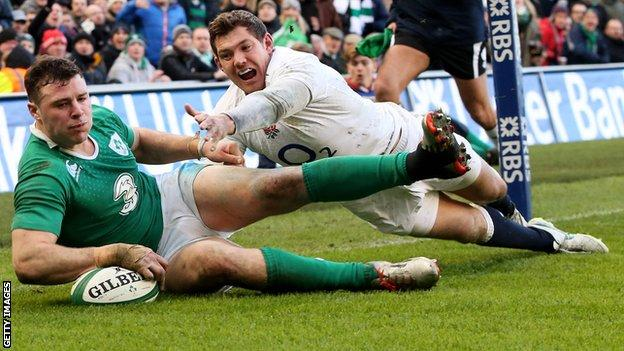 Robbie Henshaw scores Ireland's try in the win over England despite Alex Goode's efforts