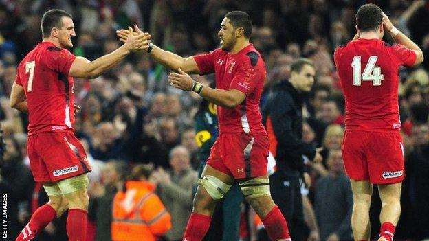 Wales players celebrate after beating South Africa in November