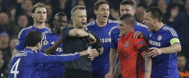 Chelsea players surrounded the referee