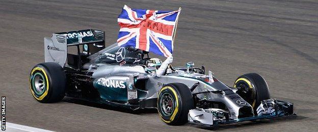 Lewis Hamilton celebrates winning the World Championship