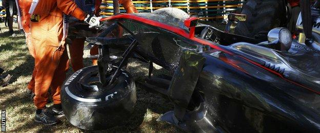 Kevin Magnussen of Denmark's car after he crashed during the second practice session of the Australian F1 Grand Prix at the Albert Park circuit in Melbourne