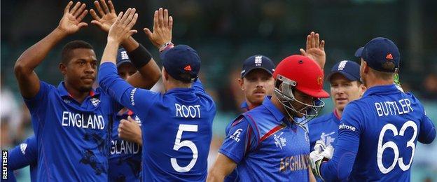 Chris Jordan (left) celebrates a wicket