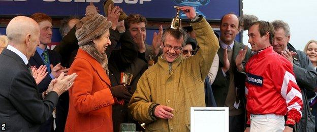 Trainer Mark Bradstock receives the trophy from The Princess Royal after Coneygree's victory