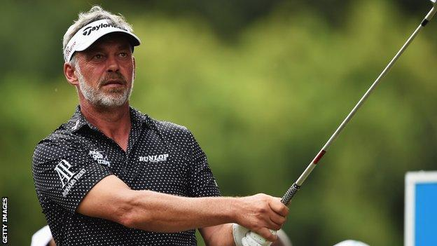 Darren Clarke plays a shot during Friday's second round