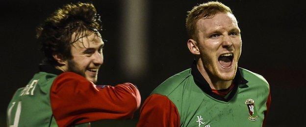 Steven Gordon runs away in delighted after scoring Glentoran's second goal in the Premiership game