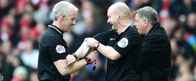 Referee Chris Foy was replaced during the game by Anthony Taylor after a calf injury