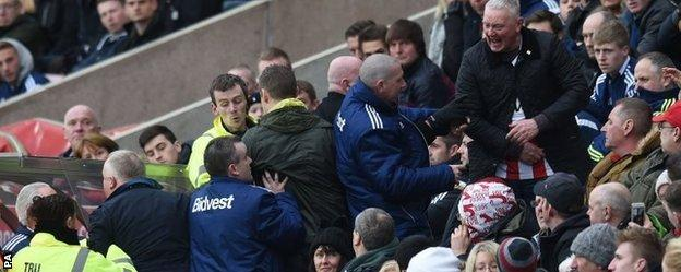 Sunderland fans attempt to get to Gus Poyet's dugout