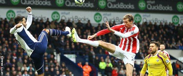 Joleon Lescott charges down Peter Crouch's header