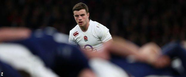 England fly-half George Ford looks on at a ruck