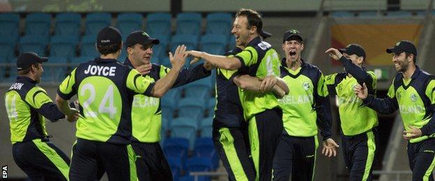 Ireland players celebrate victory over Zimbabwe