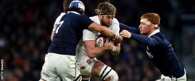 Blair Cowan and Rob Harley tackle England's Geoff Parling
