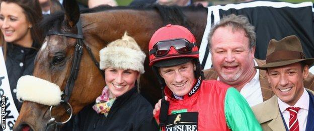 Sam Twiston-Davies celebrates Dodging Bullets win with breeder Frankie Dettori (right)