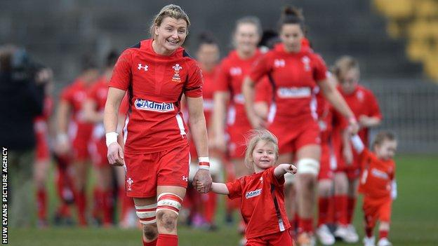 Rachel Taylor leads out the Wales side on the occasion of her 50th cap