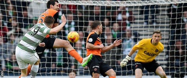 James Forrest pings home Celtic's second goal 11 minutes from full-time