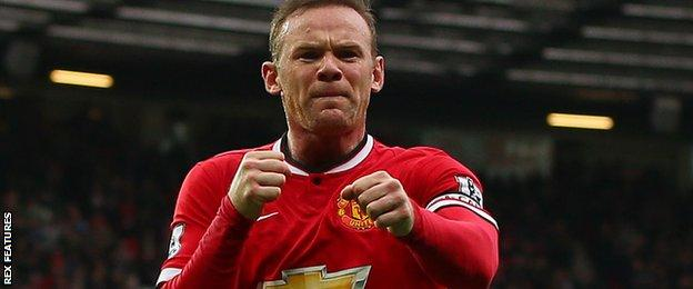 Wayne Rooney celebrates his goal by punching the air like a boxer