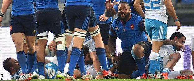 Mathieu Bastareaud smiles after scoring his try for France against Italy