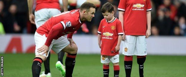 Wayne Rooney with Kai Rooney