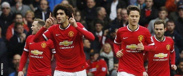 Marouane Fellaini celebrates after scoring United's first goal