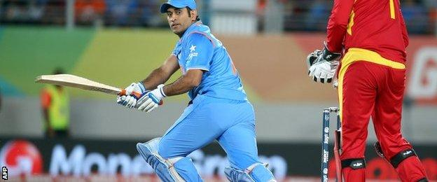 MS Dhoni sweeps a ball for four against Zimbabwe