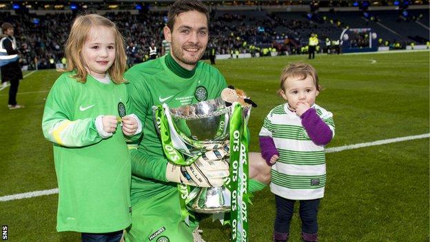 Celtic's Craig Gordon celebrates at Hampden with his children