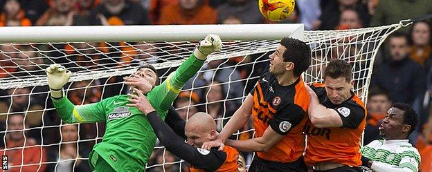Craig Gordon is challenged by three Dundee United players at Hampden