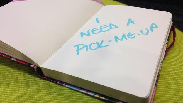 journal with words I need a pick-me-up written inside