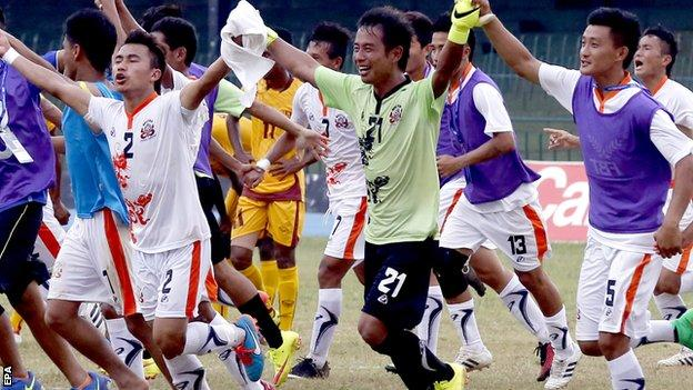 Bhutan players celebrate during their first leg victory against Sri Lanka