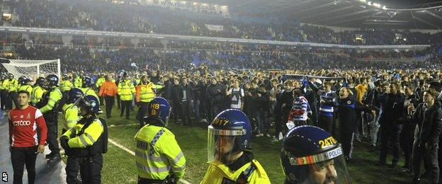 Reading fans invade the pitch at full time at the Madejski Stadium