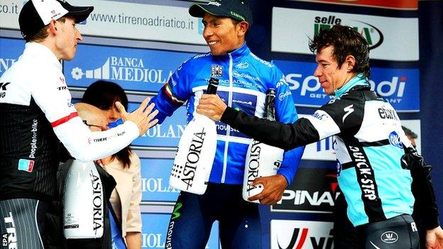 Nairo Quintana (C) of the Movistar Team is congratulated by second placed Dutch rider Bauke Mollema (L) of the Trek Factory Racing team and third placed Colombian rider Rigoberto Uran