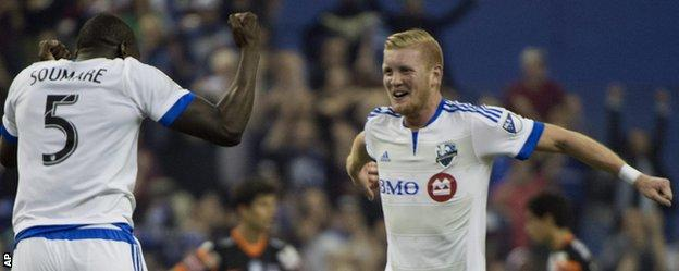 Calum Mallace (right) celebrates with Montreal Impact