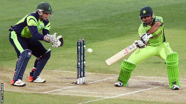 Gary Wilson looks on as Pakistan's Sarfaraz Ahmed strikes the ball in Adelaide