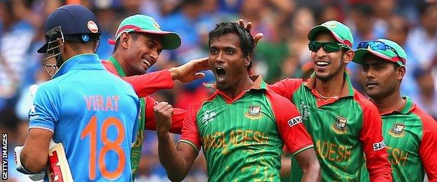 Bangladesh celebrate the dismissal of Virat Kohli