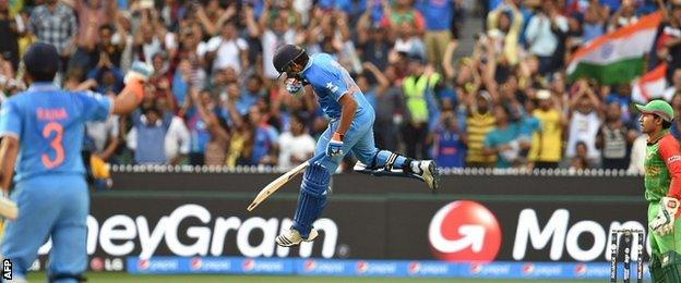Rohit Sharma celebrates scoring his century