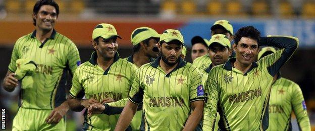 Pakistan players, including Misbah-ul-Haq (right)