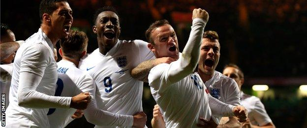 Wayne Rooney of England celebrates after scoring his team's second goal during the friendly with Scotland