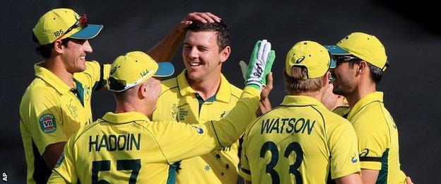 Josh Hazlewood (centre) celebrates with team-mates