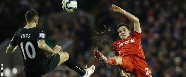 Liverpool midfielder Joe Allen challenges Burnley striker Danny Ings