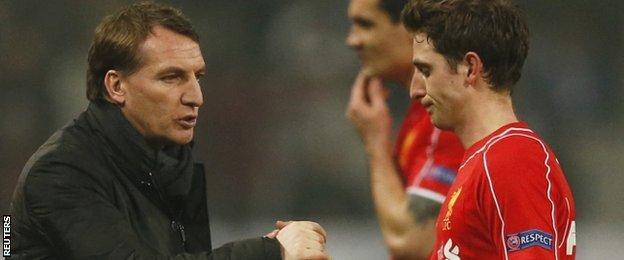 Liverpool manager Brendan Rodgers and midfielder Joe Allen