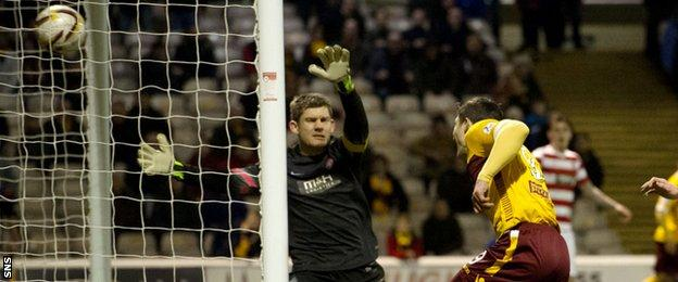 Motherwell striker John Sutton beats Hamilton keeper Michael McGovern to add to his side's lead.
